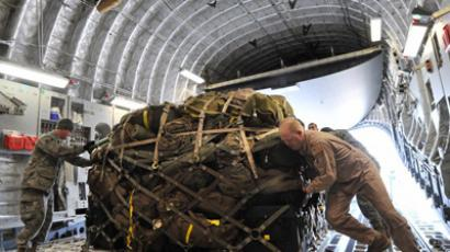 US military personnel load gear onto a plane bound for Afghanistan at the Manas Transit Center some 30kms from Bishkek (AFP Photo/Vyacheslav Oseledko)