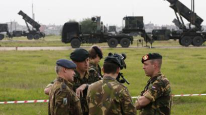 Dutch soldiers, with the Patriot system in the background, chat during media day at a military airbase in Adana, southern Turkey, January 26, 2013. (Reuters / Murad Sezer)