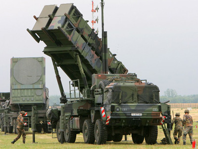 The Air Defence Missile Squadron 2 with a Patriot missile launcher during an exercise at training site Warbelow near Gnoien, northern Germany. (AFP Photo / Bernd Wustneck)