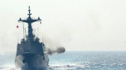 This handout picture released by the Republic of Korea (ROK) Navy shows ROKS DDH-981 Choi Young, a Chungmugong Yi Sun-shin class South Korean destroyer, firing during a joint military exercise between US and South Korean navies in the Sea of Japan (East Sea) on July 27, 2010 (AFP Photo / Roknavy)