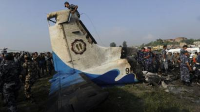 Onlookers and rescuers are seen near the wreckage of an Sita Air Dornier plane crash site in Manohara, on the outskirts of Kathmandu.(AFP Photo / Prakash Mathema)