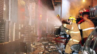 Firefighters try to put out a fire at a nightclub in Santa Maria, 550 Km from Porto Alegre, southern Brazil on January 27, 2012. (AFP Photo/Agencia RBS)