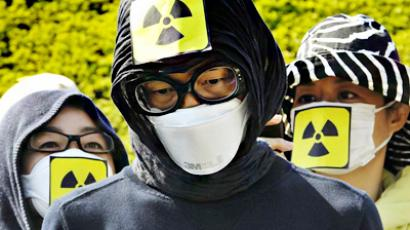 Protestors wear masks as they protest against Japan's nuclear policy during a parade for Earth Day in Tokyo on April 24, 2011 (AFP Photo / Getty Images)