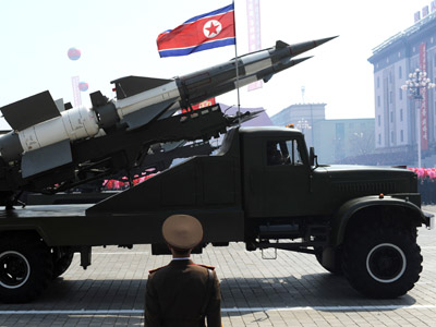 A missile is displayed during a military parade to mark 100 years since the birth of North Korea's founder Kim Il-Sung in Pyongyang on April 15, 2012. (AFP Photo/Pedro Ugarte)
