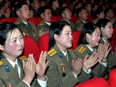 "North Korean soldiers watch a music and dance performance, ""Let Us Uphold Our Supreme Commander Forever"" in Pyongyang. (REUTERS/KCNA)"