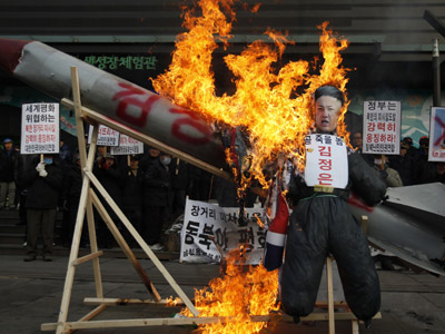 Anti-North Korea protesters burn a mock North Korean missile, its flag and an effigy of North Korean leader Kim Jong-un during a protest denouncing North Korea's rocket launch in central Seoul December 13, 2012. (Reuters/Kim Hong-Ji)