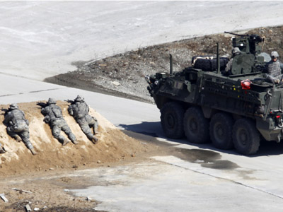 U.S. soldiers of Stryker Brigade Combat Team stage a live fire drill at Seungjin fire range during a photo call in Pocheon, about 46 km (28 miles) northeast of Seoul and about 15 km (9 miles) south of the demilitarized zone separating the two Koreas. (Reuters / Lee Jae Won)