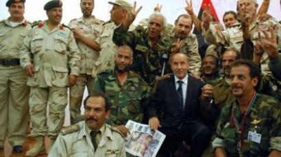 Libya's interim leader Mustafa Abdel Jalil (C) poses for a picture with National Transitional Council (NTC) fighters  (AFP Photo / Abdullan Doma)