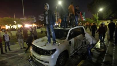 Libyans damage the car of National Transitional Council (NTC) Chairman Mustafa Abdel Jalil, to express their dissatisfaction towards the policy of the Council in governing the country, in Benghazi January 21, 2012 (Reuters / Esam Al-Fetori)