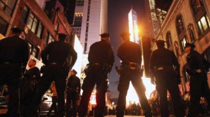 Police keep watch as demonstrators associated with the 'Occupy Wall Street' movement protest in Times Square on October 15, 2011 in New York City (Mario Tama / Getty Images / AFP)