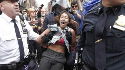 Policemen arrest an Occupy Wall Street movement supporter while they were marching from Zuccotti Park to Union Square to protest perceived police brutality in New York, March 24, 2012. (Reuters / Carlo Allegri)