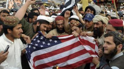 Supporters of hard line pro-Taliban party Jamiat Ulema-i-Islam-Nazaryati (JUI-N) burn a US flag during an anti-US rally in Quetta on May 2, 2012 on the first anniversary of the death of Osama bin Laden. (AFP Photo / Banaras Khan)