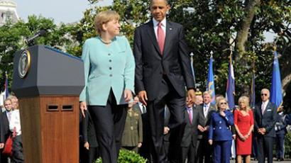 US President Barack Obama (R) greets German Chancellor Angela Merkel on the South Lawn of the White House during an official arrival ceremonoy in Washington, DC, on June 7, 2011 (AFP Photo / Jewel Samad)