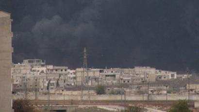 Black smoke is seen from Homs refinery December 8, 2011, Syria (Reuters / SANA / Handout)