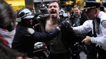 "Members of Occupy Wall Street are arrested as they struggle with police during a celebration march after learning that they can stay on at Zuccotti Park in New York, October 14, 2011 (AFP Photo / Emmanuel Dunand). Video: ""I am not moving - Short Film - Occupy Wall Street"" from CoreyOgilvie's YouTube channel"
