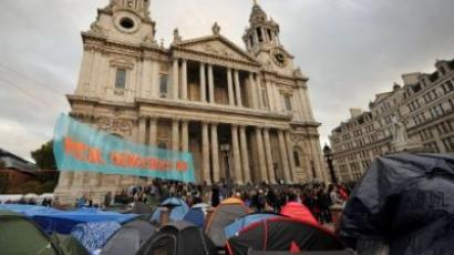 Protesters of the 'Occupy London Stock Exchange' demonstration gather on the steps of St. Paul's Cathedral behind their tents in London on November 2, 2011. (AFP PHOTO / BEN STANSALL)