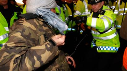 A police officer scuffles with a protester in central London November 30, 2011 (Reuters / Suzanne Plunkett)