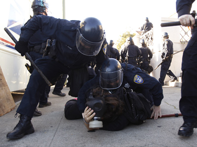 Members of the Oakland Police Department arrest an Occupy Oakland demonstrator during a confrontation in Downtown Oakland (REUTERS / Stephen Lam)