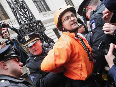 "A protester is arrested by NYPD during an Occupy Wall Street ""Shut Down the Corporations"" protest on February 29, 2012 in New York City. (AFP Photo / Timothy A. Clary)"