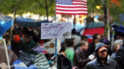 An American flag is displayed at 'Occupy Wall Street' movement`s headquarters in Zuccotti Park in the Financial District near Wall Street on November 4, 2011 in New York City (Spencer Platt / Getty Images / AFP)