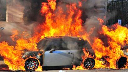 Italy, Rome: A car burns during a demonstration, in Rome on October 15, 2011 (AFP Photo / Alberto Pozzoli)