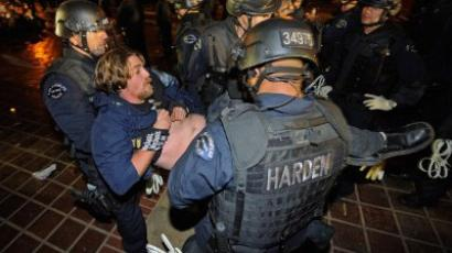 Members of Occupy Los Angeles protesters seated in circle in the middle of their encampment are arrested by Los Angeles Police Department officers after LAPD raided their protest campsite. (Kevork Djansezian/Getty Images/AFP)