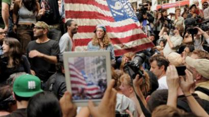 A person with an iPad takes a photograph of a large flag as demonstrators with 'Occupy Wall Street' occupy Zuccotti Park on September 30, 2011 in New York (AFP  Photo / Stan HONDA)