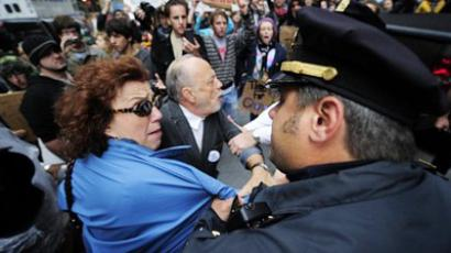 Police arrest two elderly protesters as 'Occupy Wall Street' members stage a protest march at the JP Morgan Chase Bank tower near Wall Street in New York, on October 12, 2011 (AFP Photo  / Emmanuel Dunand)