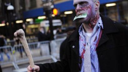 New York : An Occupy Wall Street supporter dressed as a corporate zombie (AFP Photo/Emmanuel Dunand)