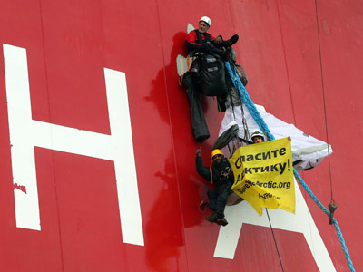 Greenpeace activists climb Russian Arctic oil rig to protest drilling