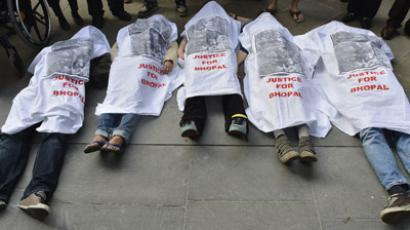 Demonstrators demanding that Dow to be dropped as an Olympics sponsor over the 1984 Bhopal disaster, which killed thousands in India, lie on the pavement outside the venue of an Olympic news conference in central London, March 30, 2012. (Reuters / Toby Melville)