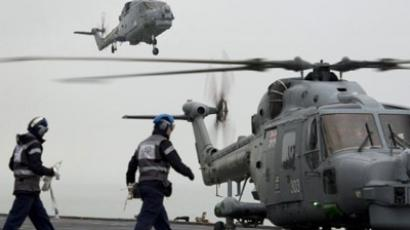 "Crewmen standby as British Royal Navy Lynx Helicopters land on helicopter carrier HMS Ocean during security rehearsals, ""Exercise Olympic Guardian"", ahead of the London 2012 Olympic Games in the Thames estuary, east of London, on May 4, 2012 (AFP Photo / Ben Stansall)"