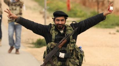 A Libyan rebel fighter flashes the Victory sign in Benghazi on March 19, 2011 (AFP Photo / Patrick Baz)