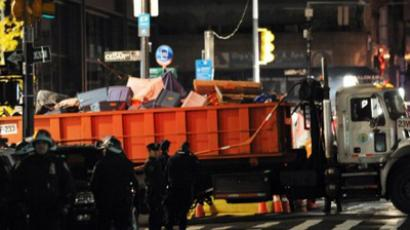 A large truck with items from Zuccotti Park drives away as New York City officials clear the 'Occupy Wall Street' protest from the park in the early morning hours of November 15, 2011 in New York (AFP Photo / Stan Honda)