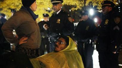 An Occupy Wall Street protester confronts the NYPD when they enforce a no sleeping rule in Zuccotti Park on November 16, 2011 in New York City (AFP Photo / Allison Joyce)