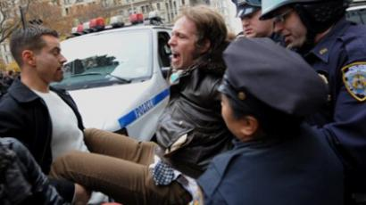 A man is arrested as demonstrators with 'Occupy Wall Street' mark the two month anniversary of the protest November 17, 2011 in New York (AFP Photo / Stan HONDA)