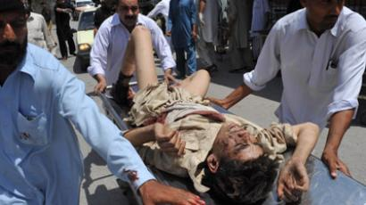 Pakistani men push a stretcher carrying an injured blast victim to a hospital in Peshawar on June 8, 2012. (AFP Photo/Hasham Ahmed)