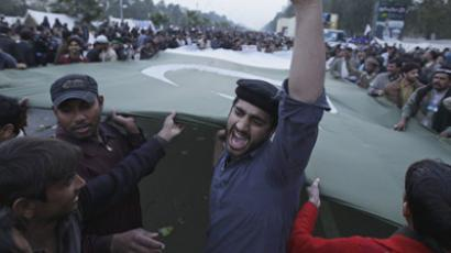 A supporter of Sufi cleric and leader of the Minhaj-ul-Quran religious organisation Muhammad Tahirul Qadri chants slogan during the third day of protests in Islamabad January 16, 2013. (Reuters/Faisal Mahmood)