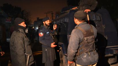 Pakistani security personnel gather near the airport after a rocket attack on an airport in Peshawar on December 15, 2012 (AFP Photo / A Majeedo)