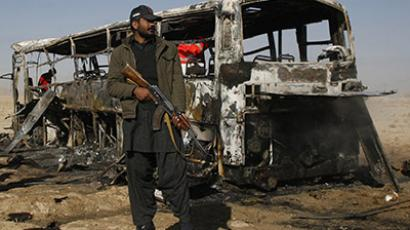 A paramilitary soldier stands guard at the site of a bomb explosion in Quetta December 30, 2012.  (Reuters/Naseer Ahmed)