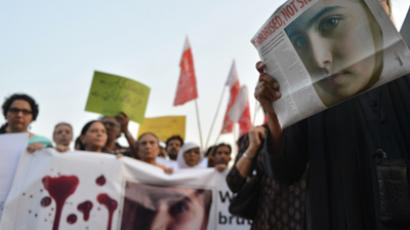Pakistani civil society activists carry placards and papers with a photograph of the gunshot victim Malala Yousafzai during a protest rally against the assassination attempt on Malala Yousafzai, in Islamabad on October 10, 2012 (AFP Photo / Aamir Qureshi)