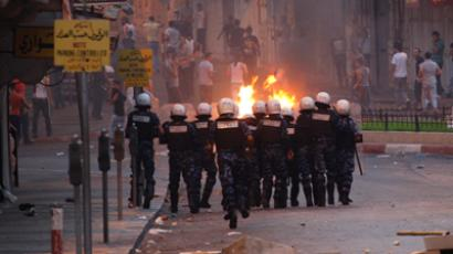 Palestinian protesters clash with riot policemen as they burn tyres during clashes following a protest in Nablus September 10, 2012 (Reuters / Abed Omar Qusini)