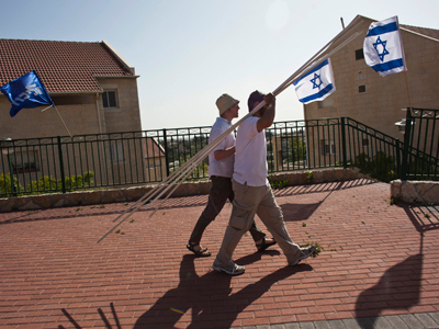 Despite internal debate, Israel stands ground on settlements