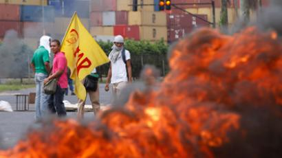 Students protest against a new government law allowing the sale of land in Panama's free trade zone of Colon, outside the university in Colon City October 18, 2012 (Reuters / Carlos Jasso)