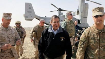 Leon Panetta is greeted after arriving to greet troops March 14, 2012 at Foward Operating Base Shukvani, Afghanistan (AFP Photo / Pool / Scott Olson)