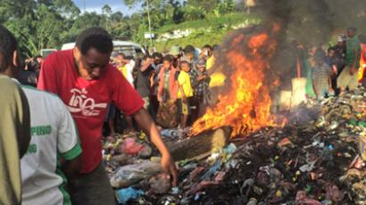 Young mother accused of sorcery who was stripped naked, reportedly tortured with a branding iron, tied up, splashed with fuel and set alight on a pile of rubbish topped with car tyres, in Mount Hagen city in the Western Highlands of Papua New Guinea on February 6, 2013 (AFP Photo / Post-Courier Papua New Guinea Out)