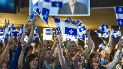 Supporters of Parti Québécois (PQ) leader Pauline Marois cheer election results on September 4, 2012 in Montreal, as voters in Canada's Quebec province cast ballots expected to bring separatists to power, amid rising frustration with the current leadership and months of student protests (AFP Photo / Rogerio Barbosa)