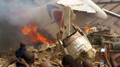 The wreckage of a plane burns in Nigeria's commercial capital Lagos, June 3, 2012 (Reuters/Stringer)