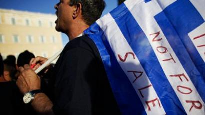 Protesters demonstrate in front of the Greek Parliament on June 12, 2011 (AFP Photo / Angelos Tzortzinis)