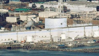 Japan races to restore cooling at nuke plant
